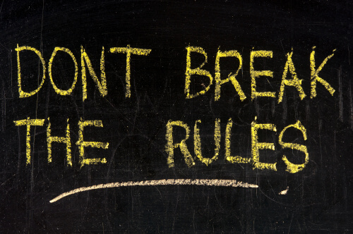 "On a black background, the words ""Don't Break the Rules"" appear as if written on a chalkboard."